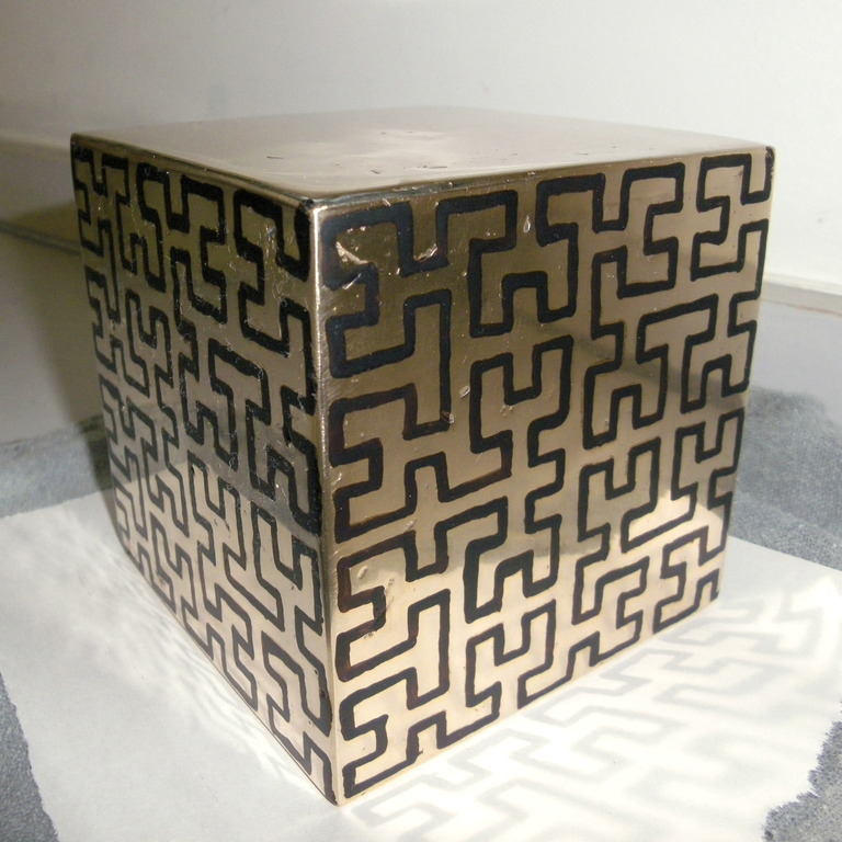 Bronze cube with resist drawn on the sides